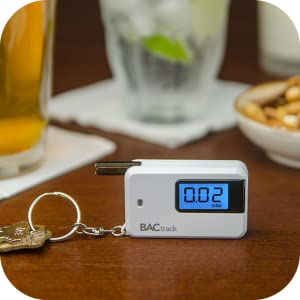 bactrack go key ring breathalizer on table