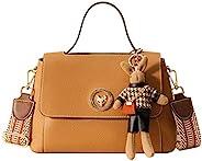 女式牛皮斜挎包女式时尚挎包手提包斜挎包带可爱娃娃装饰