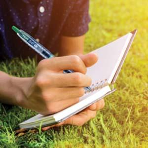 B2P - A Guy Using B2P Pilot Pen To Write In The Writing Pad