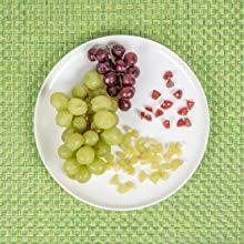 baby feeding grapes