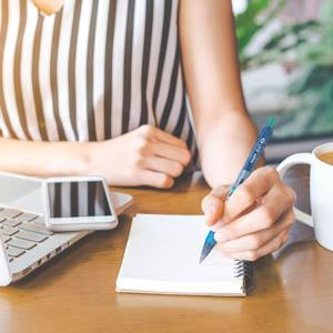 B2P - Woman Writing On The Pad Using B2P Pen
